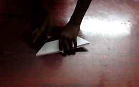 A Boy making an Origami Boat