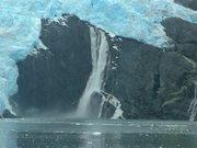 Alaska Waterfall Crashes Into Icy Waters
